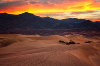 orange and yellow colors over sand dunes